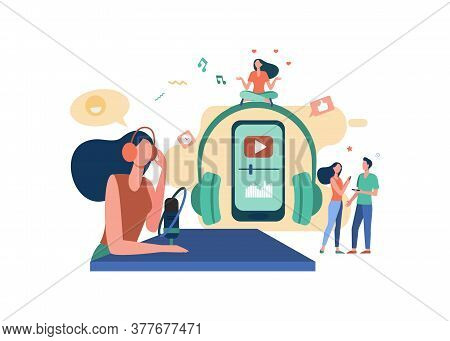 Happy Radio Host In Headset Speaking At Microphone On Air. People With Smartphones Listening To Radi