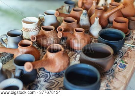 Clay Pottery Ceramics. Many Different Pottery Standing In A Potery Workshop.