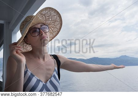 Disappointed Female Tourist On Summer Cruss Ship Vacation, Checking If It Rains, Looking Angry At Ov