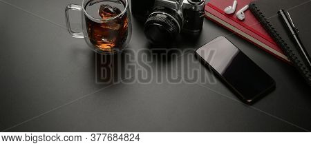 Worktable With Copy Space, Smartphone, Camera, Coffee Mug And Supplies