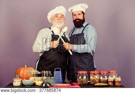 Team Work. Cereals And Seasoning. Professional Restaurant Cook. Mature Senior Bearded Men In Kitchen