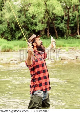 Real Happiness. Mature Man Fly Fishing. Man Catching Fish. Summer Weekend. Happy Fly Fishing. Bearde