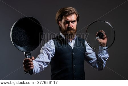 Male Housekeeper. Bearded Man In Suit Hold Pan. Man Cooking In Kitchen. Presenting Quality Utensil.