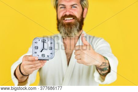 Wake Up In Morning. Time Concept. Sleepy Man Hold Alarm Clock. Noise Of Alarm Clock. Man Awake With