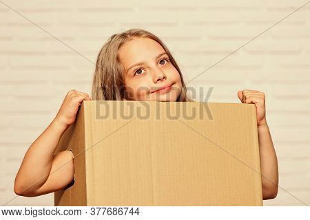Make Moving Easier. Girl Small Child Carry Cardboard Box. Move Out Concept. Delivering Your Purchase