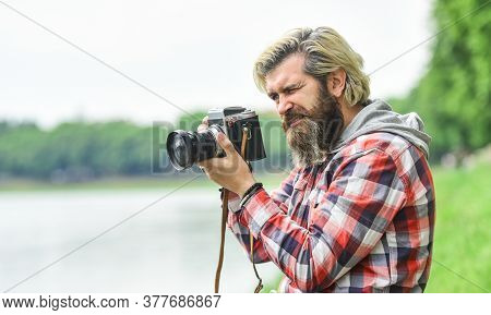 Masterpiece Shot. Man Bearded Hipster Photographer Hold Vintage Camera. Photographer Amateur Photogr