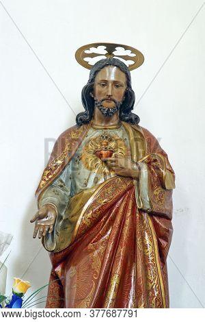 HERCEGOVAC, CROATIA - OCTOBER 01, 2011: Sacred Heart of Jesus, a statue in the church of Saint Stephen King in Hercegovac, Croatia