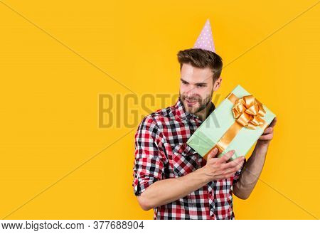 Open. Excited Handsome Guy With Gift Having Fun. Fashion Look. Enjoying Party Celebration. Expressin