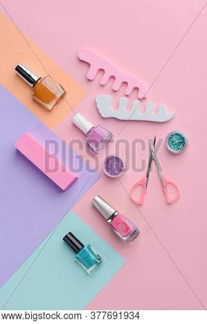 Nail Varnishes And Manicurist Tools On Multicolor Background