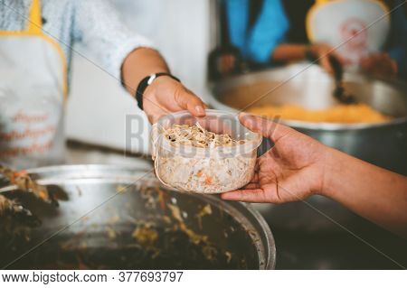 The Hands Of Beggars Receive Donated Food : Concept Of Charity Food For The Poor