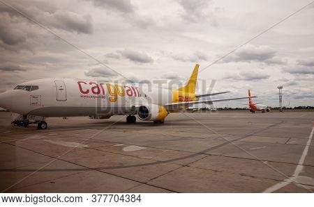 Kyiv, Ukraine - July 14, 2020: Cargo Dhl Plane Lz-cgt Boeing 737-400f. Yellow Airplane On The Platfo