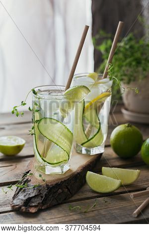 Glass Of Cucumber Soda Drink On Wooden Table. Summer Healthy Detox Infused Water, Lemonade Or Cockta