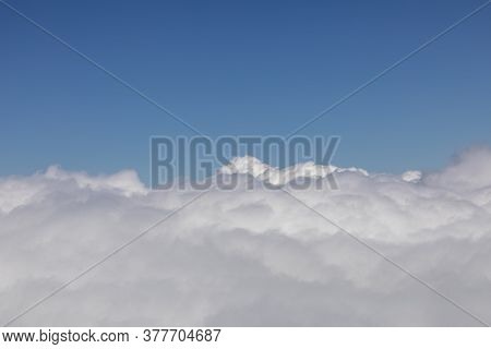 Background Of White Puffy Clouds Under Clear Blue Sky