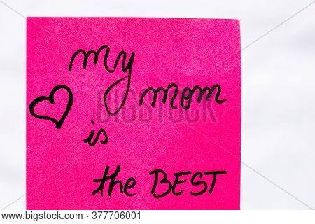 My Mom Is The Best Handwriting Text Close Up Isolated On Pink Paper With Copy Space. Writing Text On