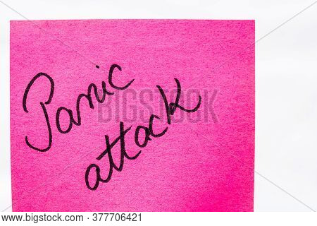 Panic Attack Handwriting Text Close Up Isolated On Pink Paper With Copy Space. Writing Text On Memo