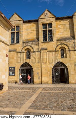 Saint-Emilion, France - August 12, 2019 : People at the main square of the small French town of Saint-Emilion. A city well known in the world for its fine wines