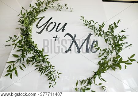 Wedding Photozone With Green Grass And With Two Words. White Photozone For Bride And Groom