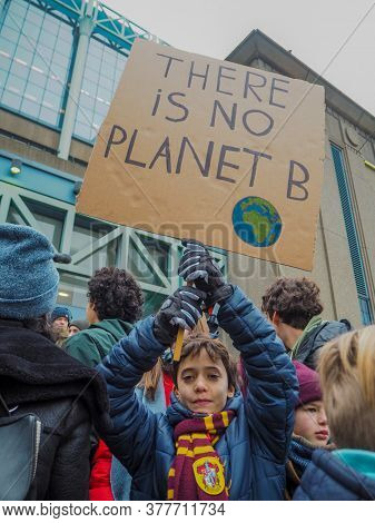 January 2019 - Brussels, Belgium: Young Boy With A Handmade Poster With Slogan In A Protest March Fo