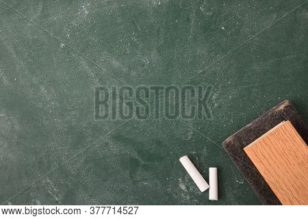 Erased And Dirty Class Blackboard With White Chalk And Eraser Close Up. Top View