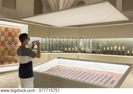 Madrid, Spain - Jul 11th, 2020: Visitor Taking Pictures Famous Gold Quimbayas Treasure At  Museum Of