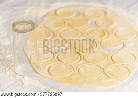 The Process Of Preparing Dough For Dumplings, Rolling Out The Dough And Cutting Circles With Womens