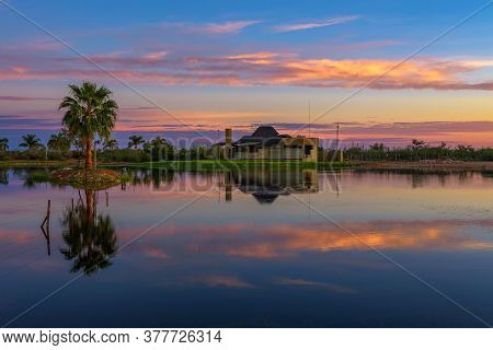 Mariental, Namibia - March 26, 2019 : Sunrise Above The Luxury Lapa Lange Game Lodge With A Lake In