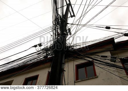 Cable Overload In The City, Data Cable Node In Front Of A House