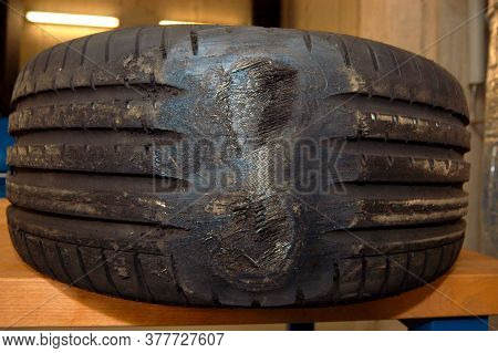 Damaged Black And Big Car Tire With A Deep Tyre Tread