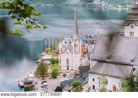 Austria, Hallstatt Unesco Historical Village. Scenic Picture-postcard View Of Famous Mountain Villag