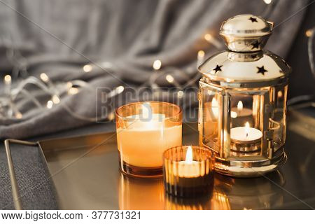 Golden Lantern And Burning Candles On A Metal Tray. Home Decor For Muslim Holidays Such As Ramadan,