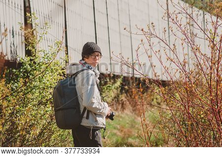 A Girl With A Backpack And A Camera Goes To The Field. Going On An Expedition In The North Of Russia