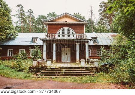 An Old Wooden Noble House With A Porch And A Balcony In The Forest. The Architecture Of The Estate O