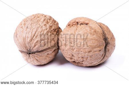 Few big walnuts isolated on white background