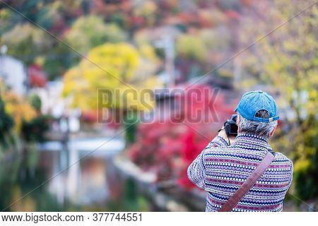 Elderly Man Tourist Taking Photo Colorful Leaves Mountains By Camera In Arashiyama, Asian Traveler V