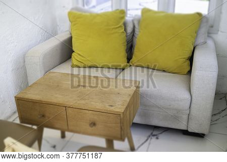 Mix And Match Sofa With Wooden Furniture, Stock Photo