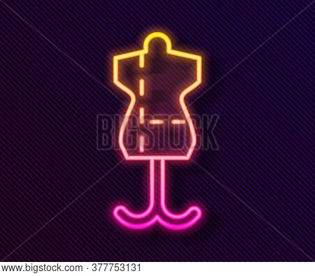 Glowing Neon Line Mannequin Icon Isolated On Black Background. Tailor Dummy. Vector