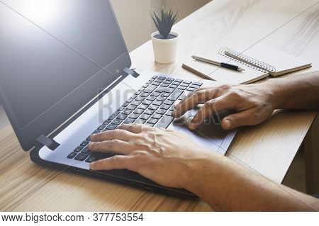 Male Hands Working On Modern Laptop - Working At Home On The Desk With Laptop - Freelancer Working W