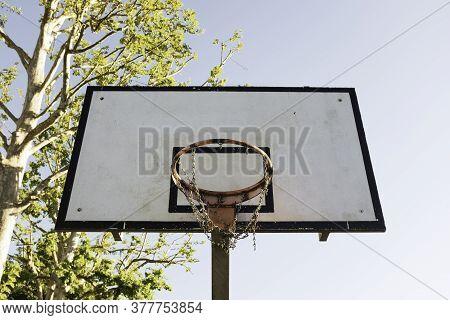 Basketball Hoop Against A Blue Sky In Sunny Day - Vintage Basketball Hoop With A Backboard - Metal B