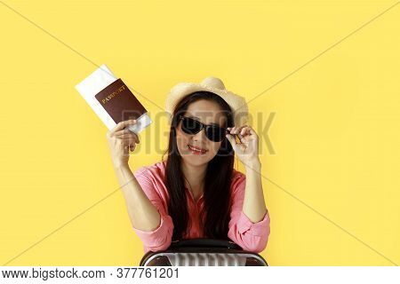 Asian Women Long Hair Wear Straw Hat, Sunglasses In Hand Holding Passport Book And Travel Bag With C