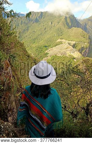 Female Traveler Impressed By The Amazing Aerial View Of The Inca Citadel Ruins Of Machu Picchu View