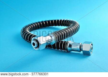Brake Hose For A Truck, Car Accessories, Auto Parts, Car Brake System Parts On A Blue Background Clo