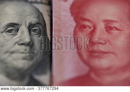 One Hundred Dollars And One Hundred Chinese Renminbi Rmb Bills. Cny Background. Closeup Of Benjamin