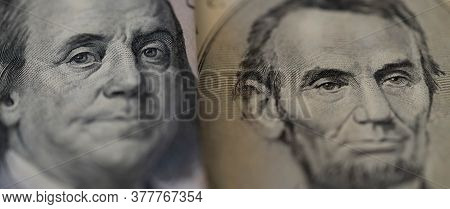 One Hundred Dollars And Five Dollar Bills. Closeup Of Benjamin Franklin And Abraham Lincoln . Us Dol