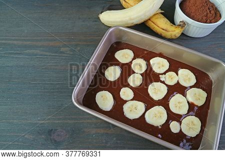 Homemade Wholemeal Chocolate Banana Olive Oil Cake Batter In Cake Pan With Ripe Bananas And Cocoa Po