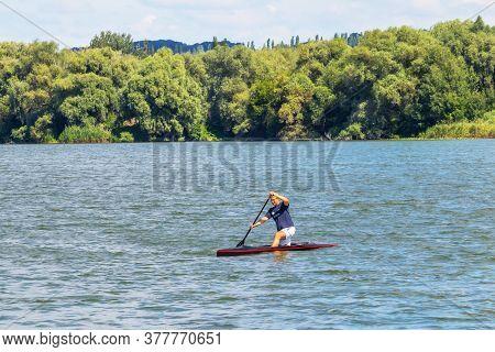 Ukraine, Khmelnytsky. July 2020. The Boy Swims In A Canoe