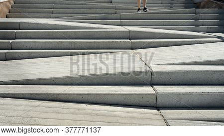Concrete Staircase And Ramp Way. Stairway Designed For Use Of Both Pedestrians And Disabled People O