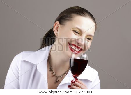 Happy Woman With Red-Wine Glass Indoors