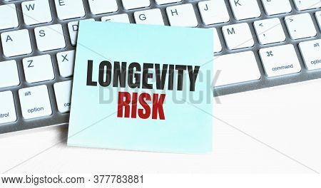 Longevity Risk Word Concept On Sticker On The Keyboard