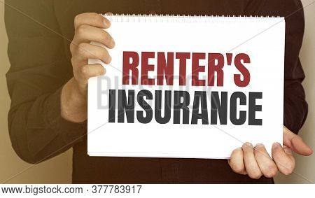 Businessman Holding A Card With Text Renters Insurance
