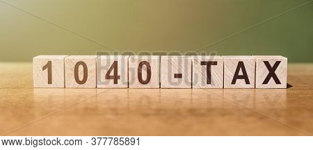 1040-tax Word Written On Wooden Blocks On Wooden Table. Financial Concept For Your Design